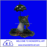 lovely stoneware garden frog with umbrella