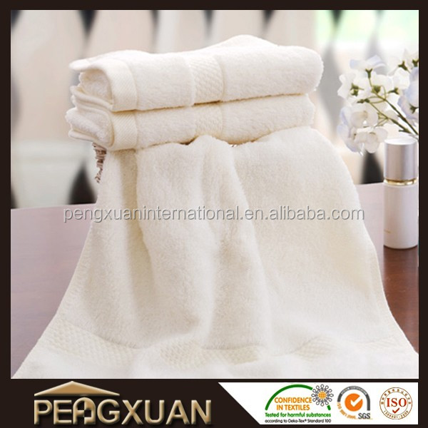 disposable cream coloured face towels hand towel and luxury bath towel for bathroom