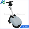 Cable powered hand floor scrubber