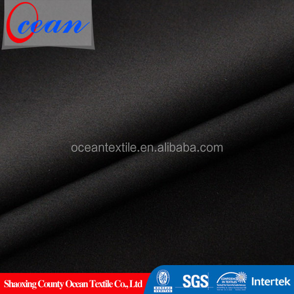 Solid woven matt satin stretch black polyester fabric