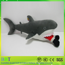Stocked stuffed blue gym shark with small fangs for adults and kids