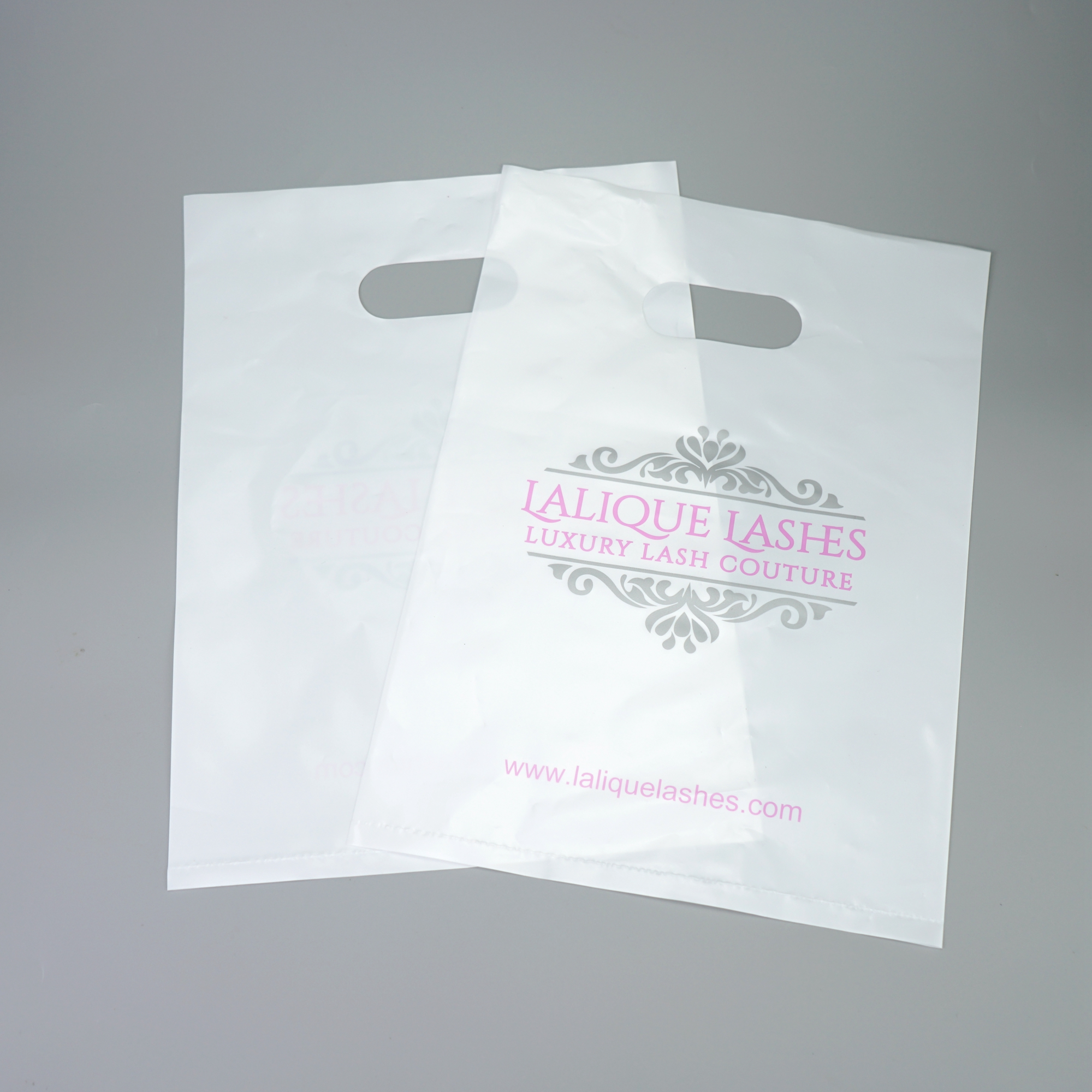Factory price plastic white die cut handle shopping bag with logo printing