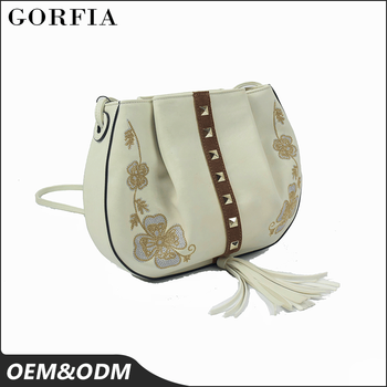 Hot sale summer ladies European and American style decoration ethnic shoulder long strip vanity bag