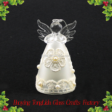 Frosted glass mini angel figurine with flower ornament