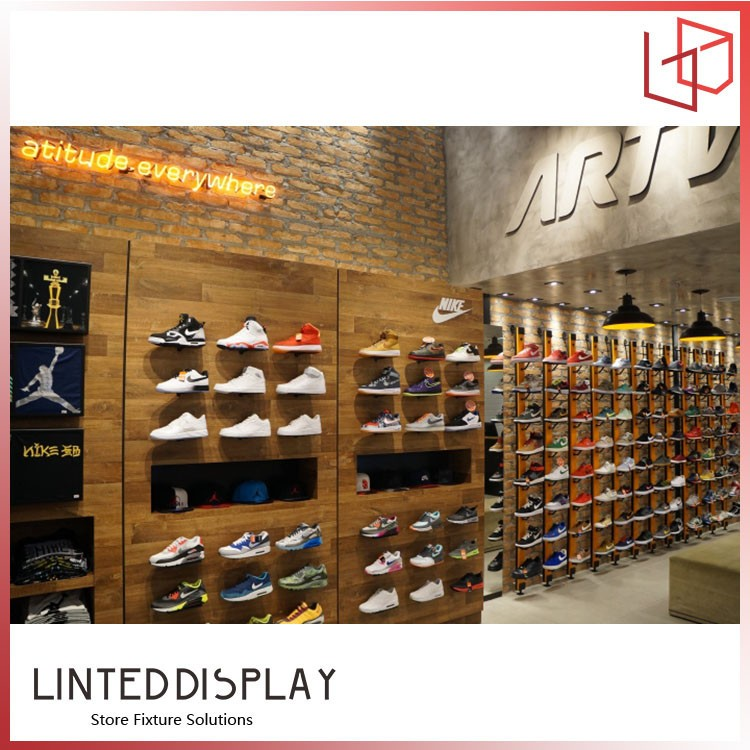 Wall mounted sport shoes display rack with led buy shoe for Sneaker wall display