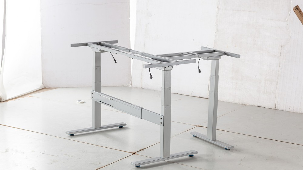 Gemotoriseerde verstelbare tafelpoot r bijgestaan door