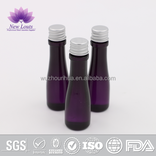 Transparent PVC plastic bottle with purple shampoo for hotel