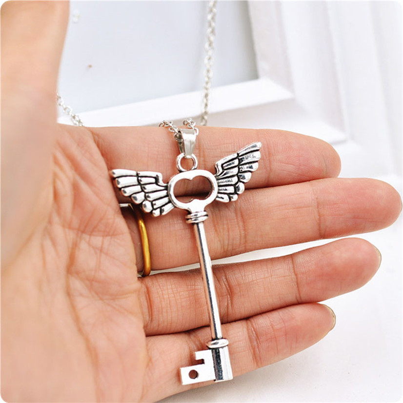 b13f618a090 Delicate Fashion New Sexy Retro Hot Women Crystal Angel wings Key  Friendship Pendant Long Chain Silver
