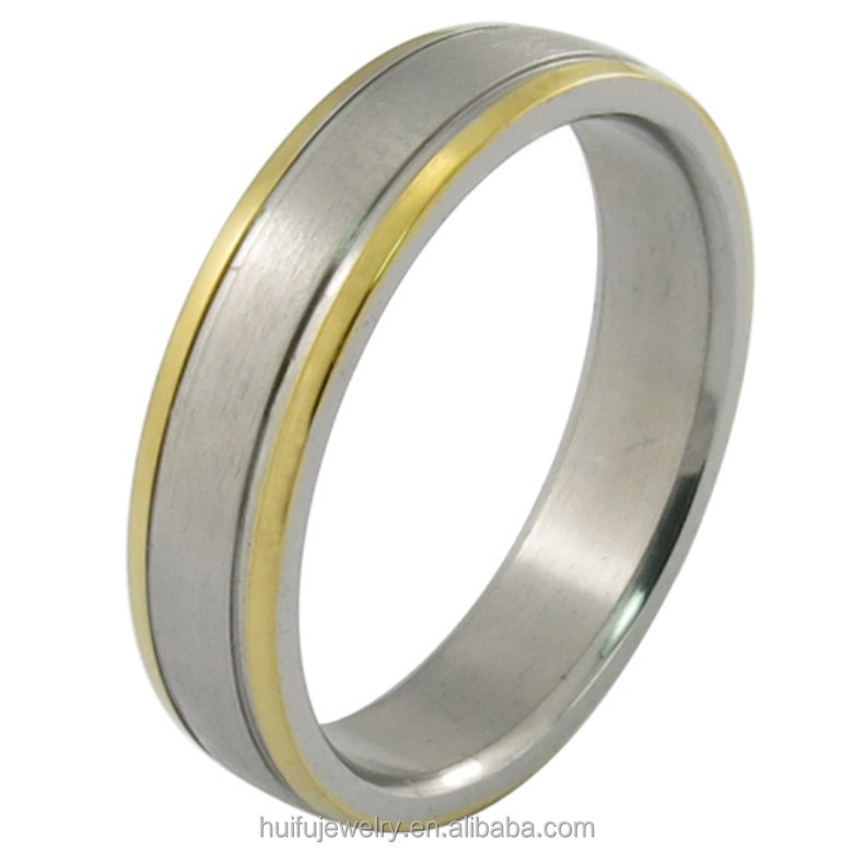 silver and gold two tone metal ring