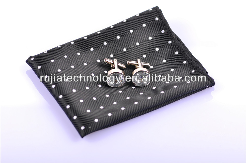 white dots in base of black pattern tie cufflink hanky set