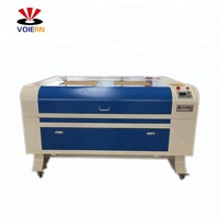 ISO ,CE certificated Wood fabric co2 laser engraving cutting machine low price
