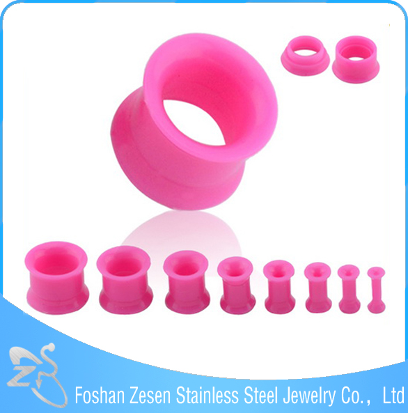Fashionable design wholesale pink acrylic piercing hollow ear gauge for sale