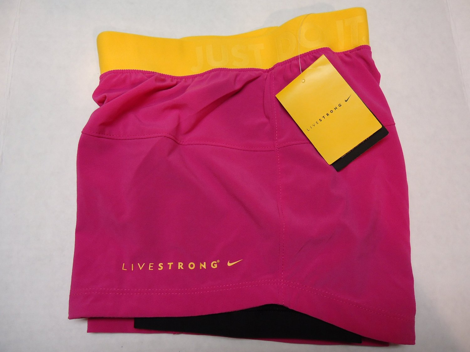 huge selection of f78d1 d9e77 Nike Women s Livestrong Shorts Pink-Yellow  JUST DO IT, X-Small