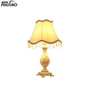 Hot sales modern European style fabric lamp shade antique brass luxurious gift parlour LED resin table lamp