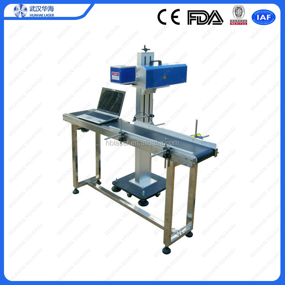 Huahai fiber laser date time serial number marking by laser coding and printing machine with automatic conveyor belt