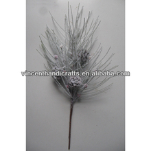 Artificial pick with pine branch and pine cones