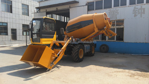 Portable self-loading concrete mixer for island construction use