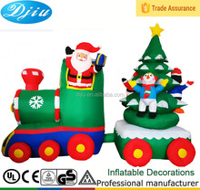 Inflatable Santa Claus Driving Train On Candy Wheels with the rotating Tree