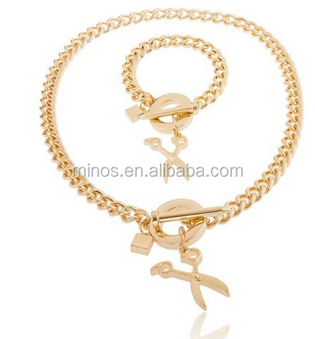Goldtone Scissors Pendant with a 21 Inch Cuban Nail Toggle Link Necklace with a Matching Bracelet Jewelry Set