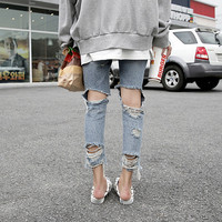 Hot-selling torn ripped jeans new fashion irregular trousers for spring/summer