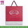 Large quantity custom made coated recycle art paper shopping bags for cloth packing wholesale in GZ