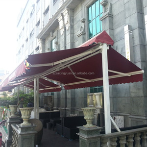 Outdoor motorized free-standing double side retractable awning