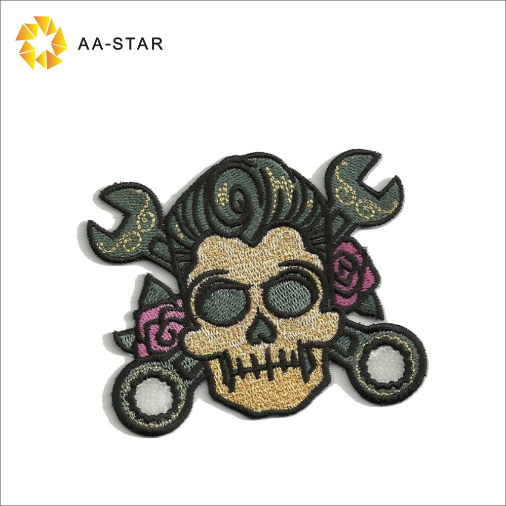 Skull with crossed wrenches pattern handmade embroidery