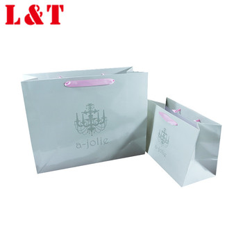 Women clothes package paper handbag with pink string handle