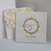 elegant hard cover invitation with gold embossed wedding invitation card