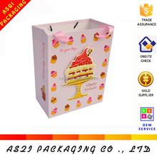 matte laminated 3 D pop up cake decoration bag with pink ribbon handles