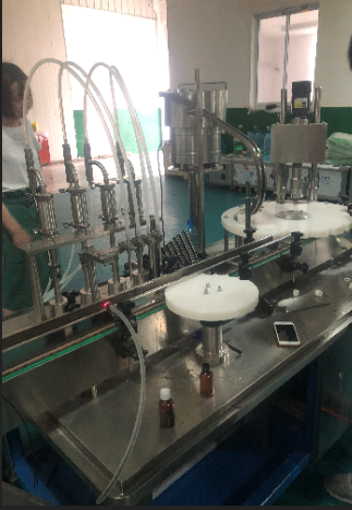 Automatic e-liquid filling capping machine peristaltic pump liquid filling machine oral liquid filling machine