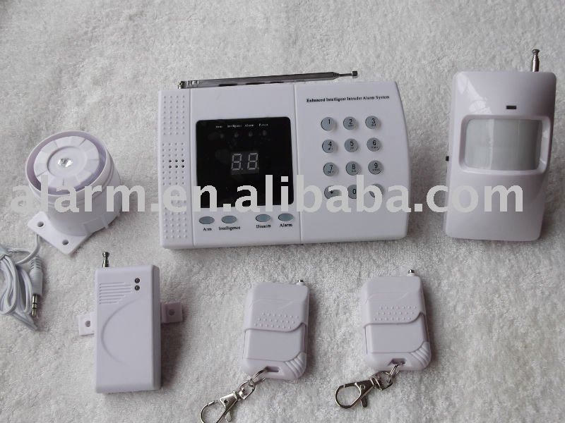 Economical auto-dial home alarm system with LED zone indication and back up battery