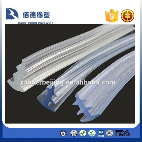 Silicone edge trim for frameless glass door