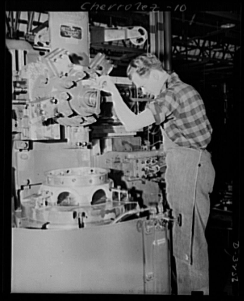 1942 Photo Auto conversion to airplane engines. On the site of an automobile assembly line, this battery of Bullard boring machines used in manufacturing of airplane engines, now stands. With normal o