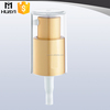 golden cosmetic cream dispenser plastic pump with clear full AS cap
