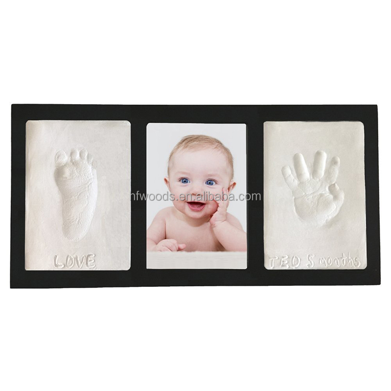 Collage black wooden baby girl / boy handprint photo picture frame with clay