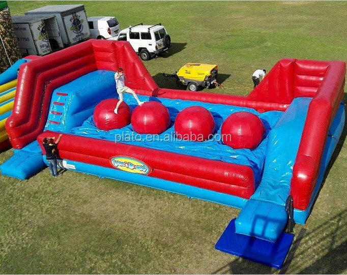 Interactive wipe out inflatable ball baller sport game /big red balls inflatable obstacle course for sale