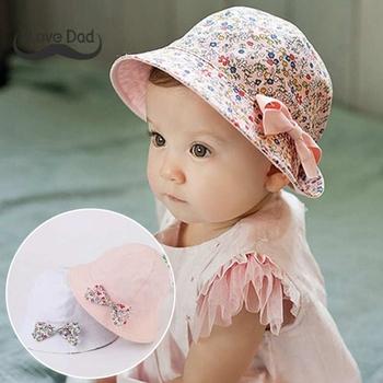 c4c5a2318ad5c Verano flor impresión algodón bebé sombrero de niñas niño Floral Bowknot  tapas el sol sombreros de