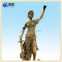 Beautiful greek goddess themis lady with sword standing on the snake book