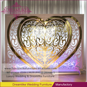 Wide white heart shape of wooden event backdrop design for wedding
