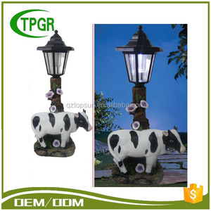 Chinese Imports Wholesale Resin Craft Cow Led Garden Light Outdoor Solar Light Price List