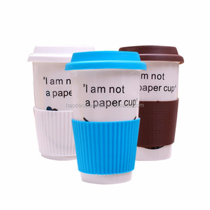 [ZIBO HAODE CERAMICS]Wholesale white ceramic mugs travel coffee mug bulk with silicone lid sleeve promotional mugs
