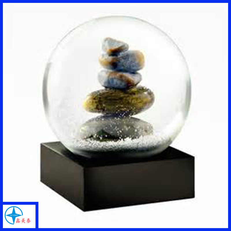 Unique stacked cobblestones snow globe