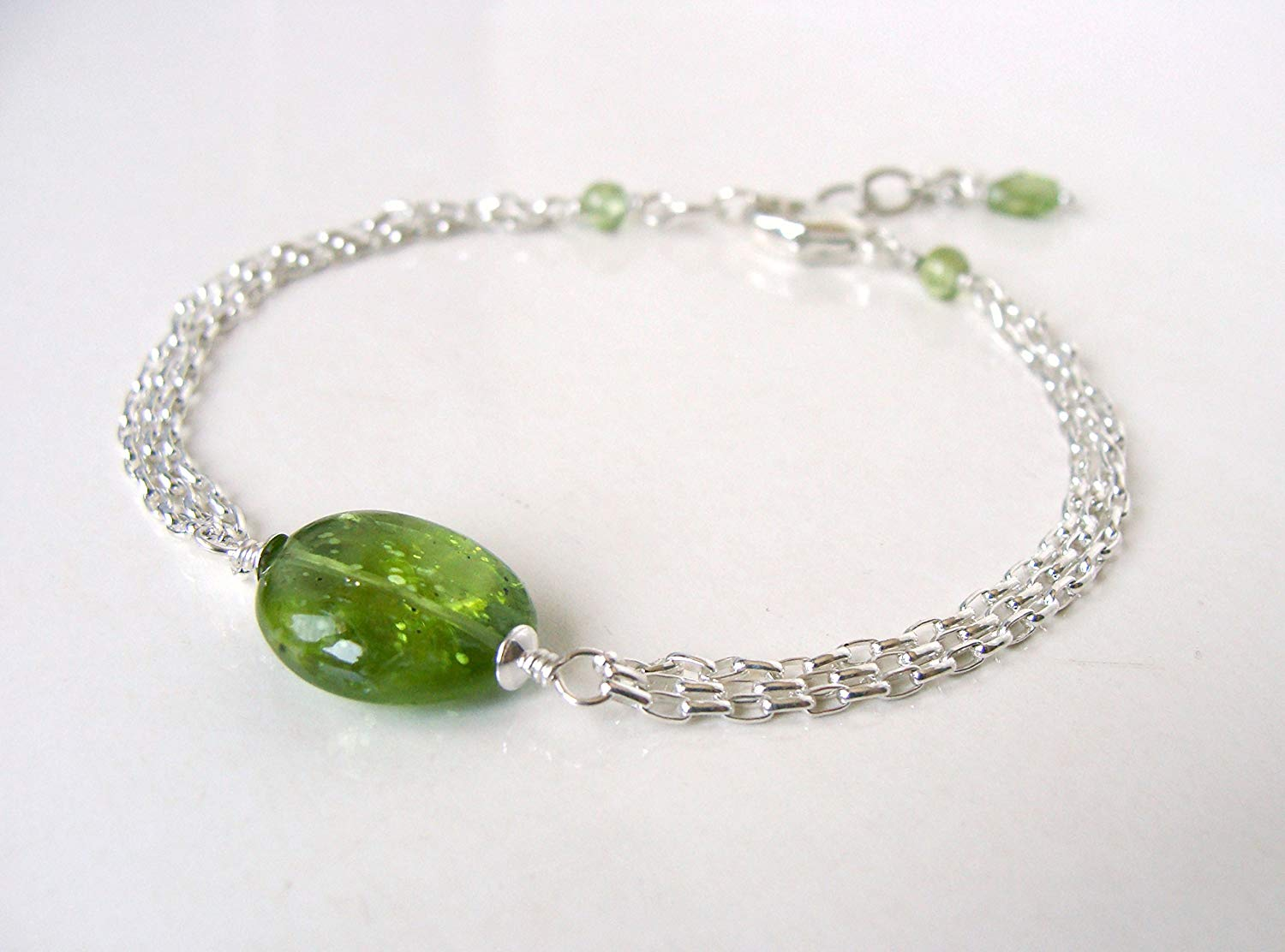 Sterling silver peridot bracelet, multistrand with large genuine peridot nugget, adjustable length, handmade by Let Loose Jewelry, August birthstone