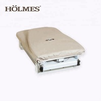 Folding wall mounted ironing board with slide holder