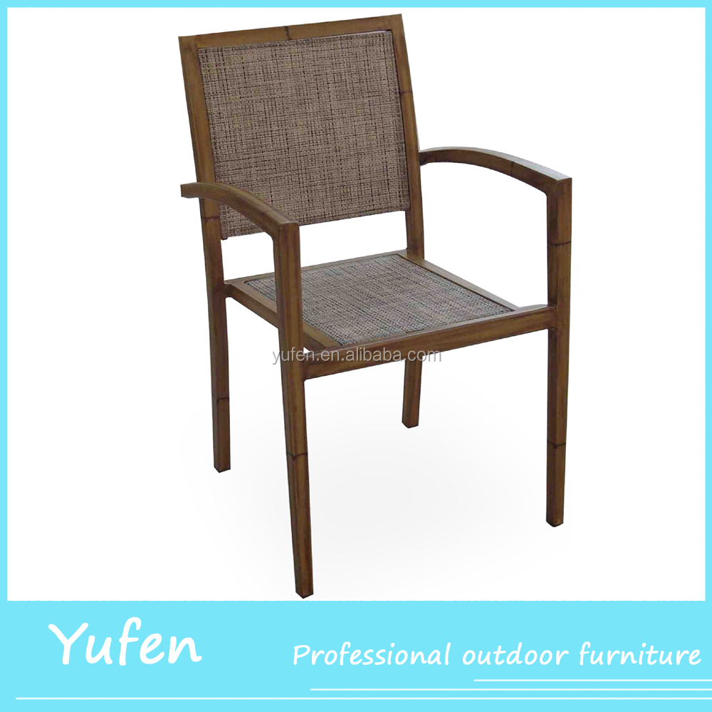 Rattan outdoor furniture dinning chair in garden