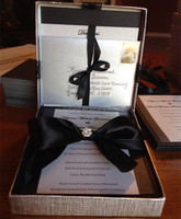 Luxurious & elegant gray box wedding invitations with black ribbons & crystal brooches