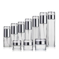 Hot sell custom 30ml 40ml 50ml 60ml 80ml 100ml 120ml 150ml frosted glass cosmetic bottle with sliver pump sprayer