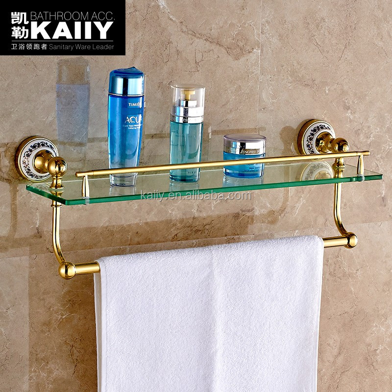 Turquoise and gold bathroom decor for Gold bathroom decor