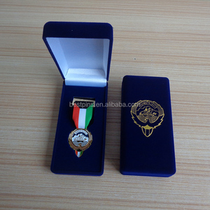 Kuwait emblem metal medal packed in velvet blue gift box with golden foil color
